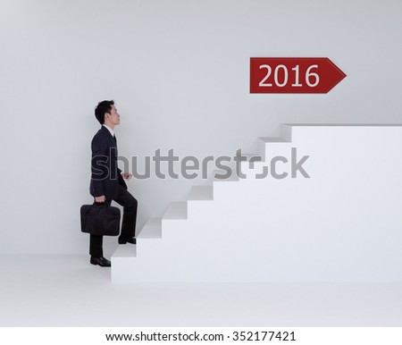 Business man stepping up on stairs to 2016 new year - stock photo