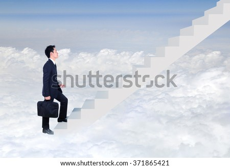 Business man stepping up on stairs with cloud and sky background (business success concept)