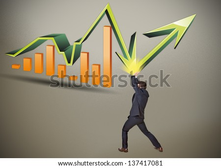 business man stops the crisis with bar graph - stock photo