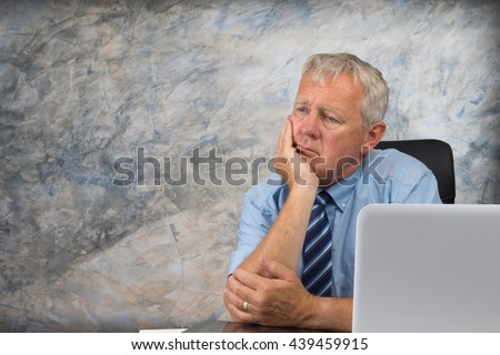Business man stressed and under pressure, selective focus - stock photo