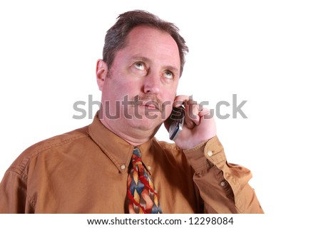 Business Man stressed out talking on his cellular phone with eyes rolled up on a white background.