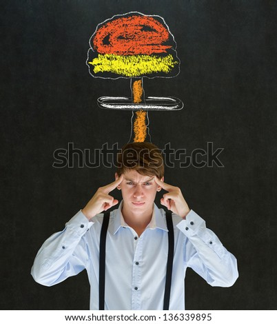 Business man, student or teacher with thought thinking chalk nuclear bomb cloud on blackboard background - stock photo
