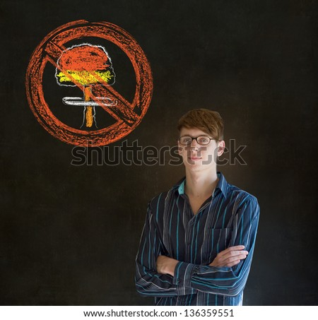 Business man, student, teacher or politician no nuclear bombs war pacifist thought thinking chalk cloud on blackboard background - stock photo