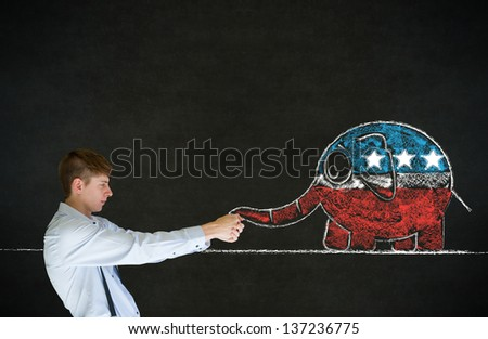 Business man, student, teacher or politician pulling republican politics elephant on blackboard background - stock photo