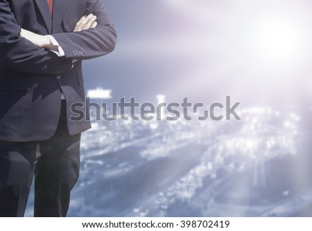 Business man success or soft Business man success in he working on marketing online or e learning with global learning on over blurred top city view with light flare from corner.  - stock photo