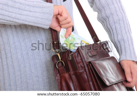 business man taking money from his bag - stock photo