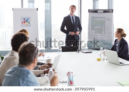 Business man talking about project during meeting in modern office. - stock photo