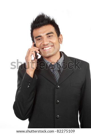 business man talking on the phone and smiling - stock photo