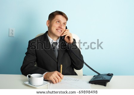Business man talking on the phone in the office
