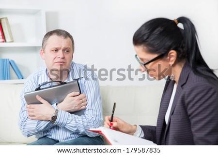 Business man talking to his psychiatrist - stock photo