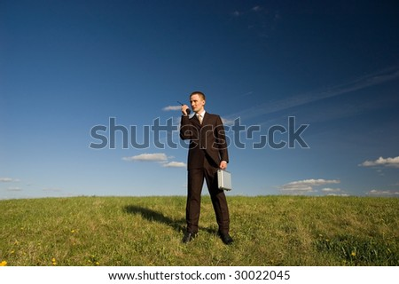 Business man talking with radio - stock photo