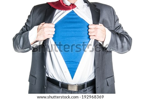 Business man tearing shirt to become a superhero - stock photo