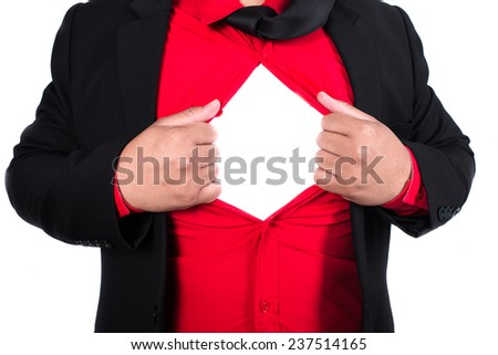 business man tears open his shirt in a super hero fashion - stock photo