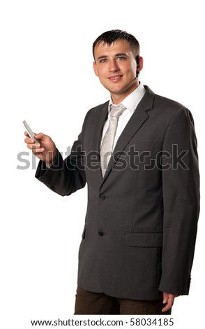 Business man texting from his cell phone isolated - stock photo