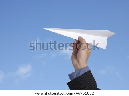 business man throwing a paper plane - stock photo
