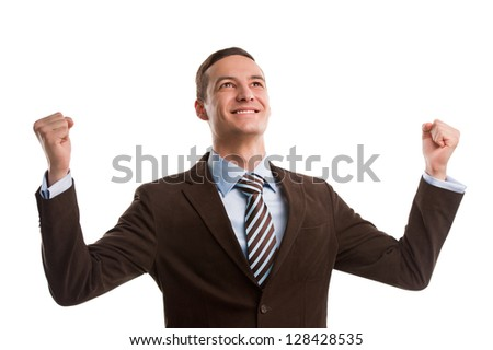 Business man throwing fists in air and smiling while celebrating success isolated on white background - stock photo