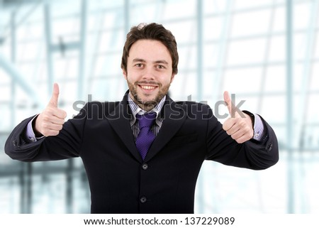 Business man thumbs up on - stock photo