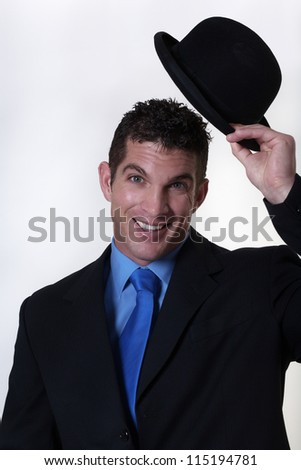 business man tipping his hat as a sign - stock photo
