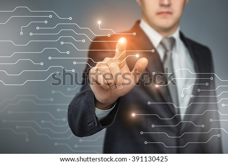 Business man touch digital icons and charts on the holographic interface. Virtual technology concept - stock photo