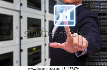 Business man touch on graph icon - stock photo