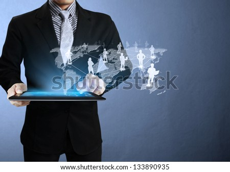 Business man touch screen ,touch- tablet in hands - stock photo