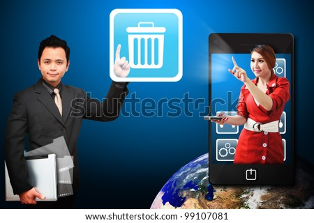 Business man touch the Bin icon from mobile phone : Elements of this image furnished by NASA - stock photo