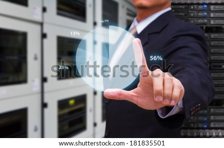 Business man touch the graph - stock photo