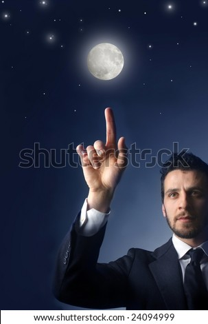 business man touch the sky, stars and moon - stock photo