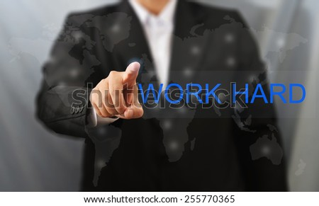 business man touch work hard word - stock photo