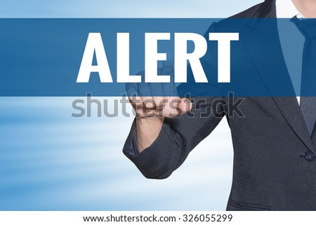 Business man touching Alert word on blue virtual screen - stock photo
