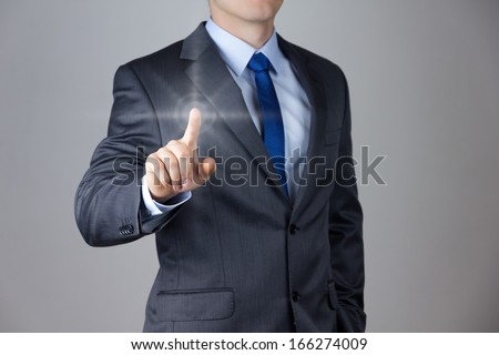 Business man touching an imaginary screen - stock photo