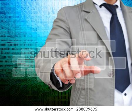 Business man touching an imaginary screen. - stock photo