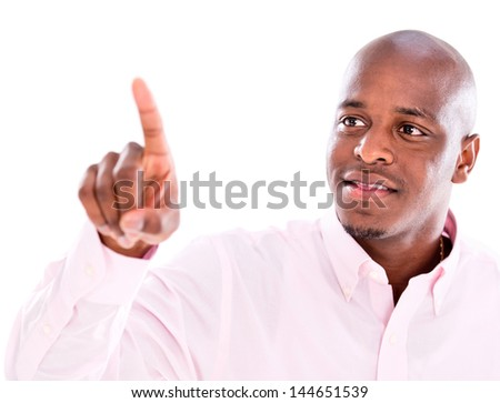 Business man touching an imaginary screen - isolated over a white background - stock photo