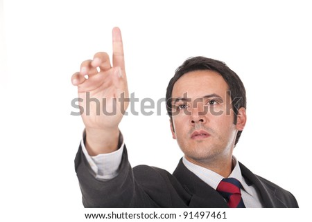 Business man touching an imaginary screen or button - stock photo