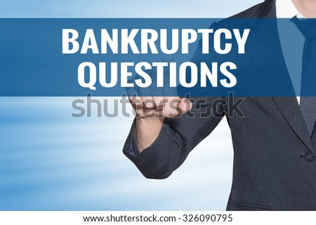 Business man touching Bankruptcy Questions word on blue virtual screen - stock photo