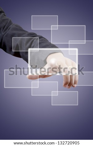 Business man touching button on blue background