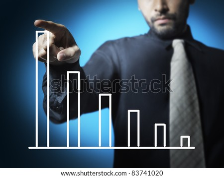 Business man touching graph of stock market - stock photo