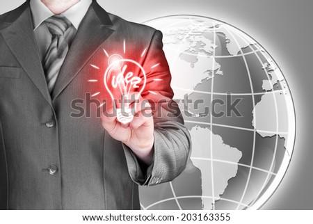 Business man touching light of idea - stock photo