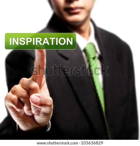 Business man touching on inspiration button - stock photo