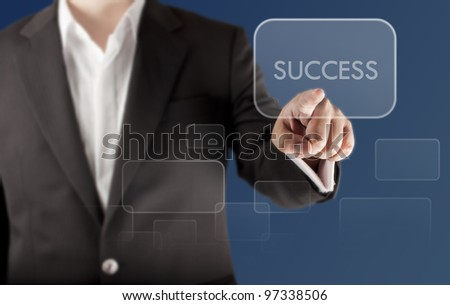 "Business man touching on touchscreen with ""SUCCESS"" wording"