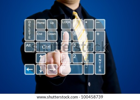Business man touching on virtual numeric keypad