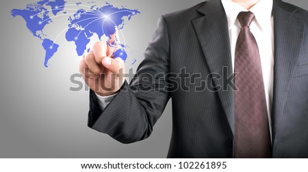 Business man touching on world map screen for social and connectivity concept - stock photo