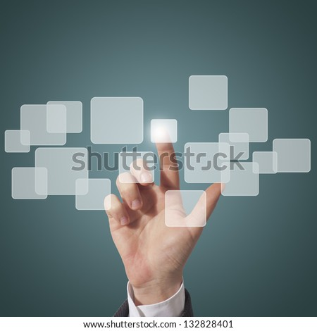 business man touching virtual screen, blue background
