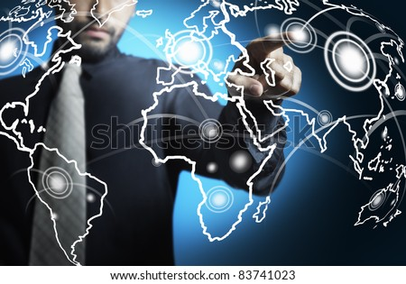 Business man touching world map screen - stock photo