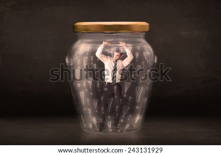 Business man trapped in jar with exclamation marks concept on bakcground - stock photo