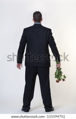 business man trying to give someone flowers - stock photo