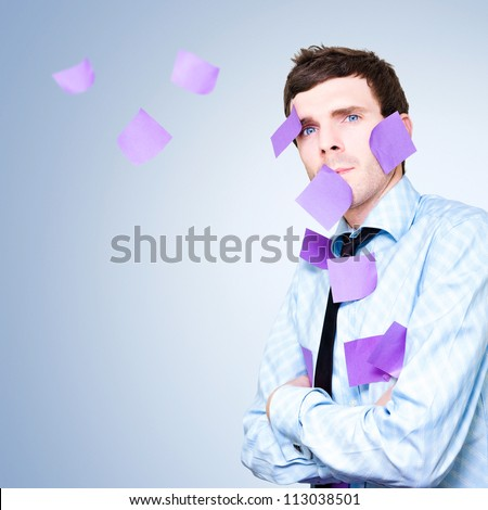 Business Man Under Corporate Stress With A Massive To Do Schedule Of Sticky Notes Flying In Air As Appointments Are Missed - stock photo