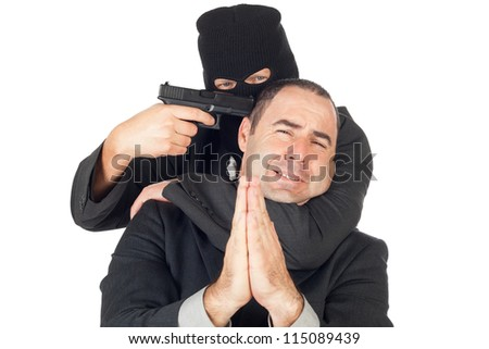 Business man under threat of death, asking to be saved - stock photo