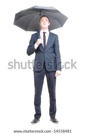 Business man under umbrella - stock photo