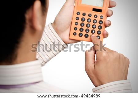 Business man use calculating machine on white background. - stock photo